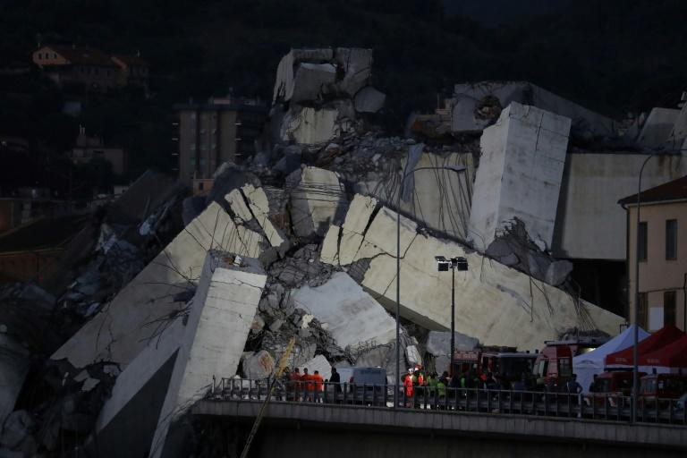 Rescuers worked through the rubble of the Morandi motorway bridge in Genoa overnight in the hope of finding more survivors