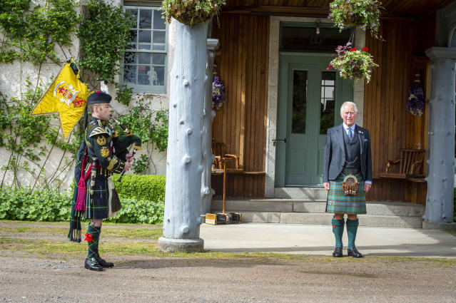 Prince of Wales taking a salute as a piper plays during a St Valery commemoration at his Birkhall residence in Scotland. (Poppyscotland/PA Wire)