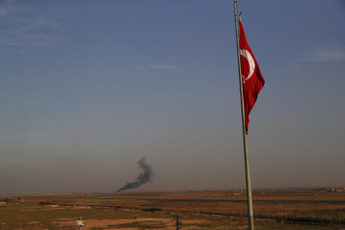 In this photo taken from the Turkish side of the border between Turkey and Syria, in Akcakale, Sanliurfa province, southeastern Turkey, smoke billows from a fire inside Syria during bombardment by Turkish forces, Oct. 9, 2019. (Photo: Lefteris Pitarakis/AP)