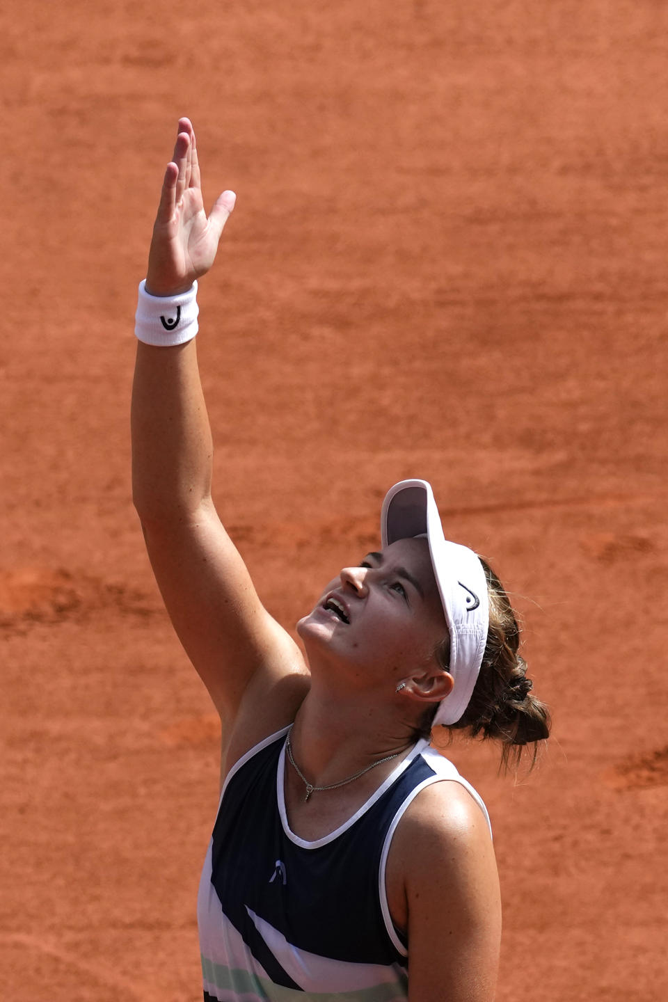 Czech Republic's Barbora Krejcikova celebrates after defeating Russia's Anastasia Pavlyuchenkova during their final match of the French Open tennis tournament at the Roland Garros stadium Saturday, June 12, 2021 in Paris. The unseeded Czech player defeated Anastasia Pavlyuchenkova 6-1, 2-6, 6-4 in the final. (AP Photo/Christophe Ena)