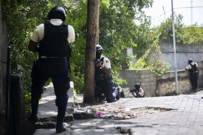 Police search the Morne Calvaire district of Petion Ville for suspects who remain at large in the murder of Haitian President Jovenel Moise in Port-au-Prince, Haiti, Friday, July 9, 2021. Moise was assassinated on July 7 after armed men attacked his private residence and gravely wounded his wife, first lady Martine Moise. (AP Photo/Joseph Odelyn)