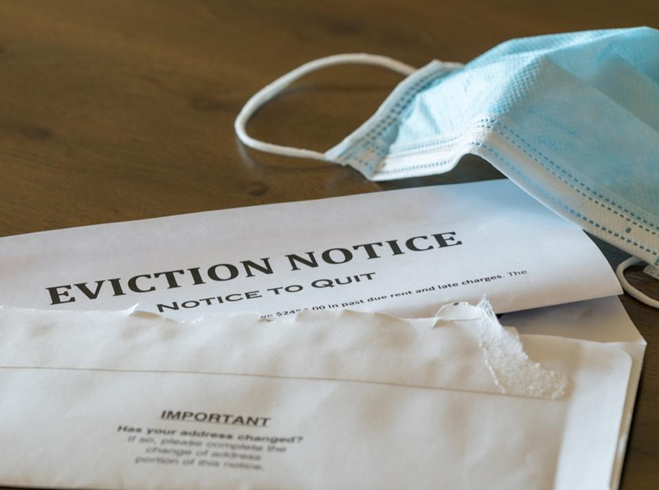 Eviction notice on table with mask
