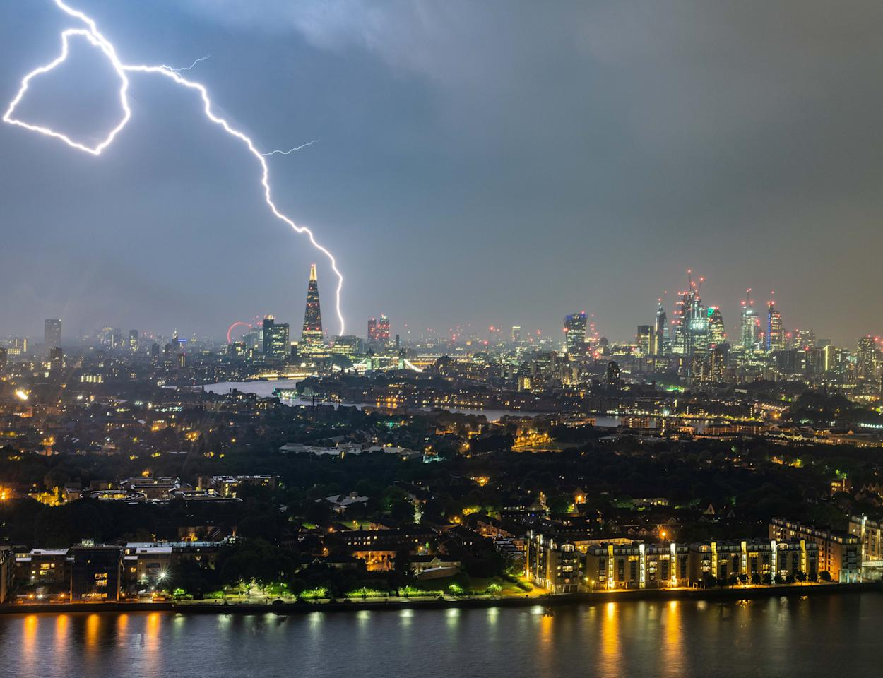 """<p>Meteorologists said the UK was struck by lightning between 15,000 and 20,000 times as the """"mother of all thunderstorms"""" rolled across southern England overnight (Picture: SWNS) </p>"""