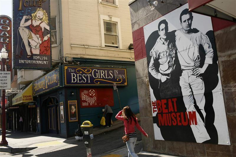 The figures of author Jack Kerouac (L) and Neal Cassady are painted on the wall of the Beat Museum in the North Beach neighborhood in San Francisco, California.