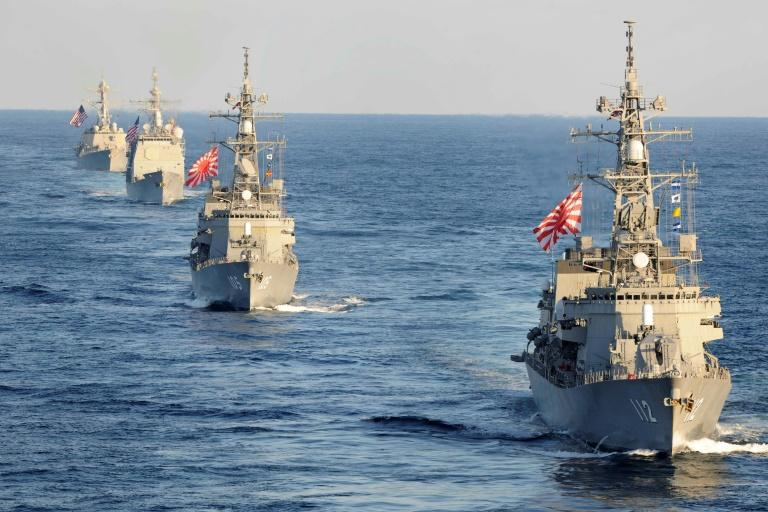 Japanese Maritime Self-Defense Force destroyer JS Makinami, (front), followed by the destroyer JS Inazuma, and two US Navy guided-missile cruisers, USS Bunker Hill and USS Preble, transiting the western Pacific Ocean in November 2017