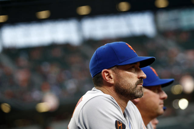 New York Mets manager Mickey Callaway stands in the dugout in the second inning of a baseball game against the Baltimore Orioles, Tuesday, Aug. 14, 2018, in Baltimore. (AP Photo/Patrick Semansky)