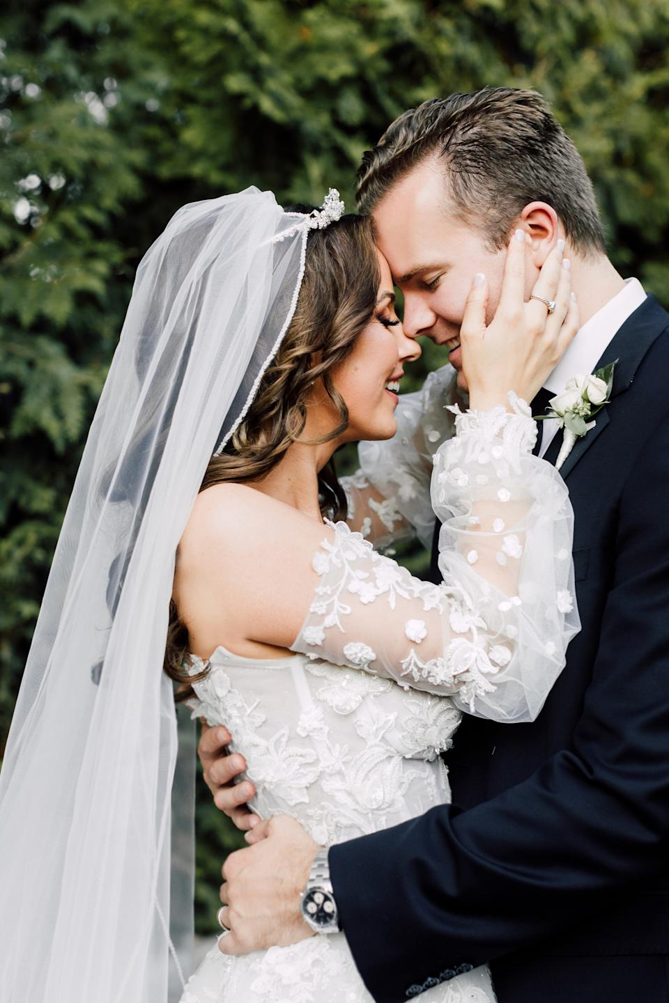 "Erika Brown and Cody Gifford embrace in a wedding photo Brown captions, ""Happily ever after."""