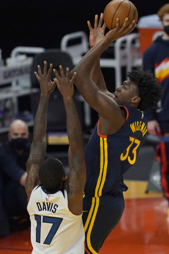 Golden State Warriors center James Wiseman (33) shoots over Minnesota Timberwolves forward Ed Davis (17) during the first half of an NBA basketball game in San Francisco, Monday, Jan. 25, 2021. (AP Photo/Jeff Chiu)