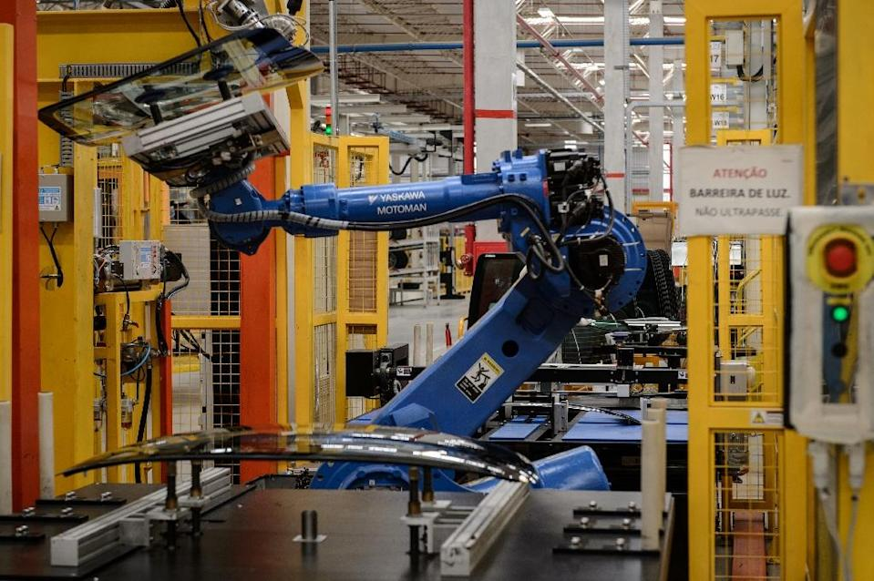 Automation and robotization have revolutionized the industrial sector over the last 40 years, raising productivity but cutting down on employment (AFP Photo/Yasuyoshi Chiba)