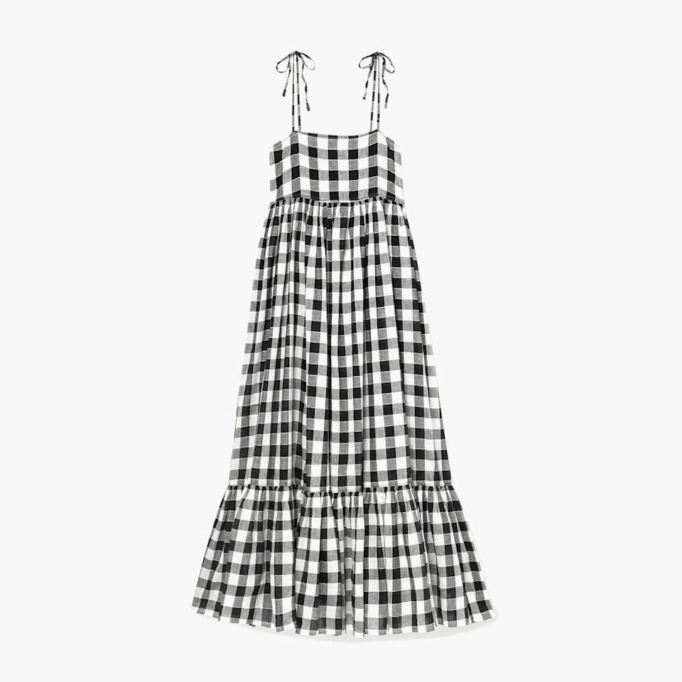 "$350, NET-A-PORTER. <a href=""https://www.net-a-porter.com/en-us/shop/product/the-great/clothing/midi-dresses/the-dainty-gingham-linen-and-cotton-blend-midi-dress/2204324139255254"" rel=""nofollow noopener"" target=""_blank"" data-ylk=""slk:Get it now!"" class=""link rapid-noclick-resp"">Get it now!</a>"