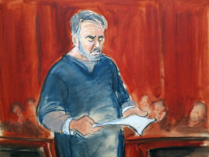 In this courtroom sketch, Manssor Arbabsiar, center, reads a statement Thursday, May 30, 2013, in Manhattan Federal Court, in New York before the judge sentenced the former used car salesman from Corpus Christi, Texas, to 25 years in prison in a failed conspiracy to kill the Saudi Arabian ambassador to the United States by bombing a Washington restaurant. (AP Photo/Elizabeth Williams)