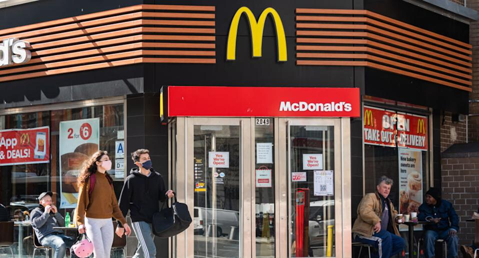 People with face masks are pictured outside McDonald's in New York.