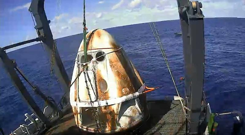 This still image taken from NASA TV shows SpaceX's Crew Dragon spacecraft safely aboard the company's recovery vessel following splashdown