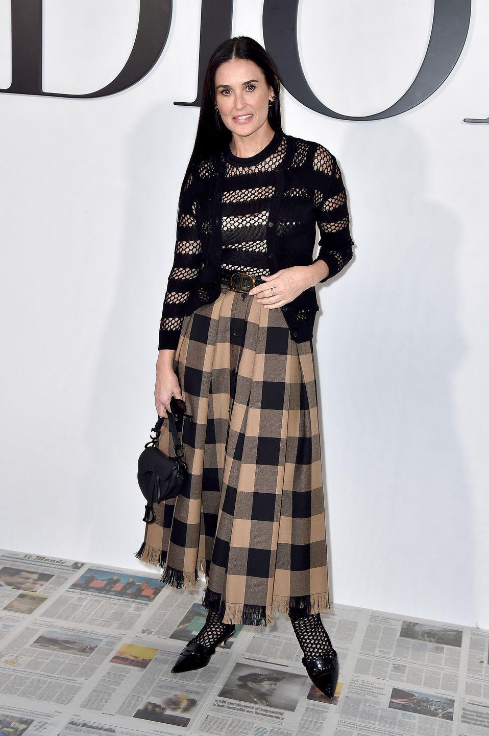 <p>Demi Moore accessorised her Dior outfit with the iconic saddle bag. </p>