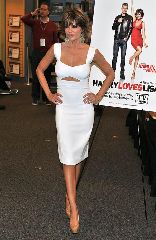 "Former ""Melrose Place"" minx Lisa Rinna popped by a book store in New York on Monday to promote her new novel, <i>Starlit</i>, her new show, ""Harry Loves Lisa,"" and her new lips while smoldering in a skintight frock, which featured an interesting keyhole cut-out. Henry S. Dziekan III/<a href=""http://www.gettyimages.com/"" target=""new"">GettyImages.com</a> - October 5, 2010"