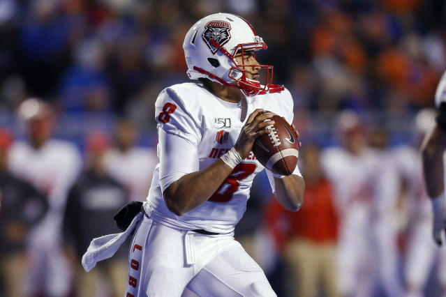 New Mexico quarterback Tevaka Tuioti looks downfield during the first half of the team's NCAA college football game against Boise State on Saturday, Nov. 16, 2019, in Boise, Idaho. (AP Photo/Steve Conner)