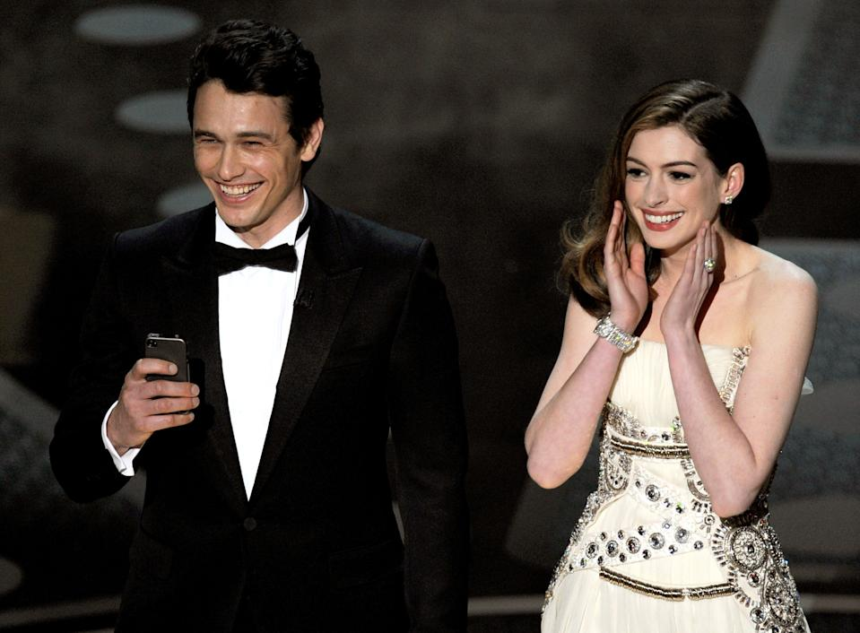 James Franco and Anne Hathaway speak onstage during the 83rd Annual Academy Awards held at the Kodak Theatre on February 27, 2011 in Hollywood, California.  (Photo by Kevin Winter/Getty Images)