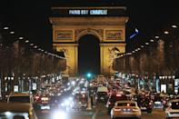 """""""Paris est Charlie"""" (Paris is Charlie) is projected onto the Arc de Triomphe in Paris, on January 9, 2015, to pay tribute to the victims of a deadly attack on the Paris headquarters of French satirical weekly Charlie Hebdo"""
