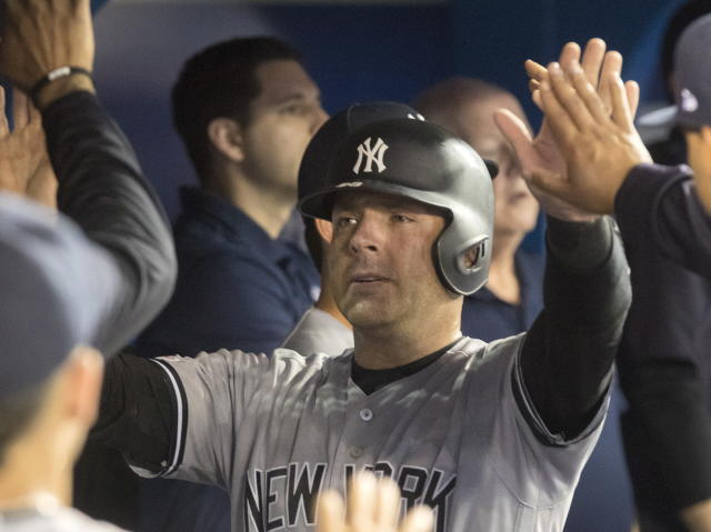 New York Yankees' Austin Romine celebrates in the dugout after scoring against the Toronto Blue Jays in the fifth inning of a baseball game in Toronto, Friday, Sept. 13, 2019. (Fred Thornhill/The Canadian Press via AP)