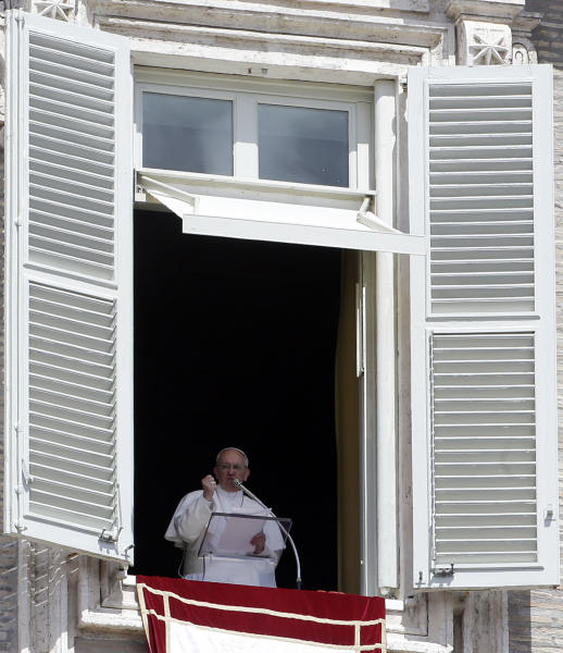Pope Francis delivers his message during the Regina Coeli noon prayer in St. Peter's Square at the Vatican, Sunday, April 21, 2013. (AP Photo/Gregorio Borgia)