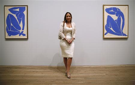 "Sophie Matisse poses with ""Blue Nude III"" at the Tate Modern gallery in London"