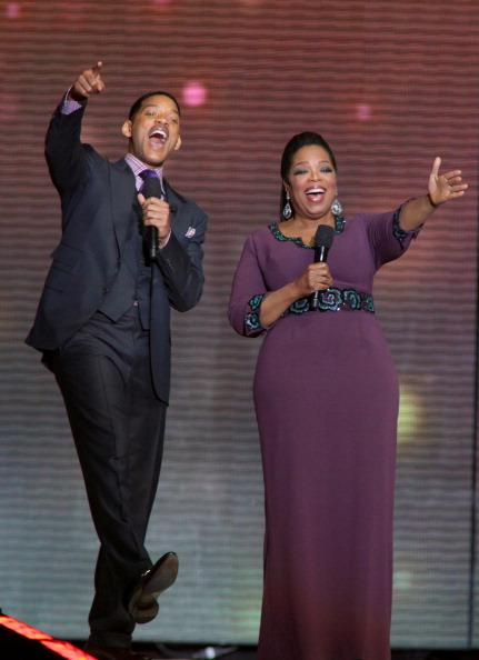 Will Smith (L) and Oprah Winfrey attend Surprise Oprah! A Farewell Spectacular at the United Center on May 17, 2011 in Chicago, Illinois.
