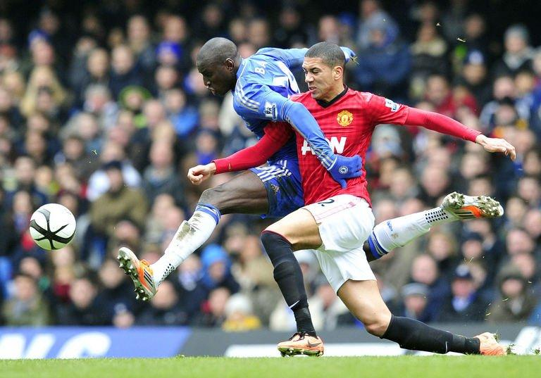 Manchester United's Chris Smalling (R) vies with Chelsea's Demba Ba (L) at Stamford Bridge on April 1, 2013