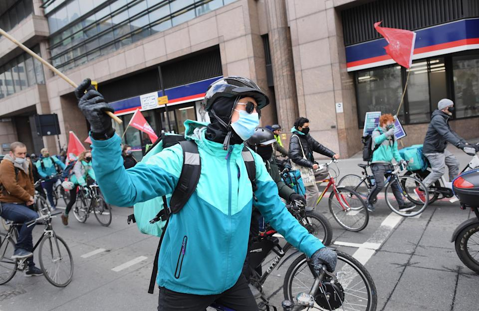 Deliveroo riders from the Independent Workers' Union of Great Britain (IWGB) in the City of London, as they go on strike in a dispute for fair pay, safety protections and basic workers' rights. Picture date: Wednesday April 7, 2021.