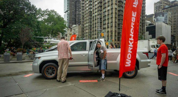 A Workhorse W-15 hybrid electric pickup truck on display at a branding event in Flatiron Plaza in New York.