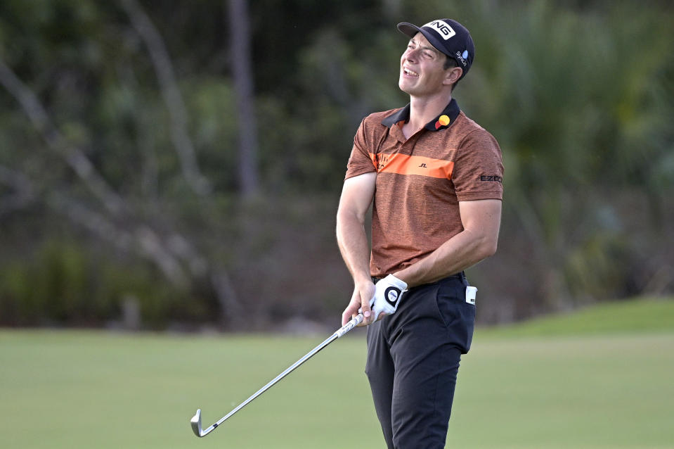Viktor Hovland, of Norway, reacts after hitting from the 18th fairway during the third round of the Workday Championship golf tournament, Feb. 27, 2021, in Bradenton, Fla. (AP Photo/Phelan M. Ebenhack)
