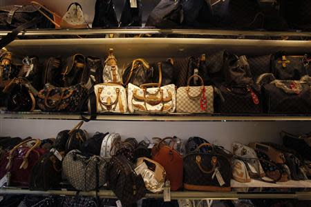 Second-hand luxury handbags are displayed at a Milan Station outlet in Hong Kong