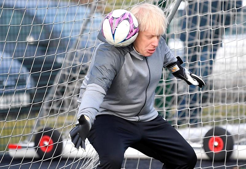 PM Boris Johnson using his head during a game of football (Getty Images)