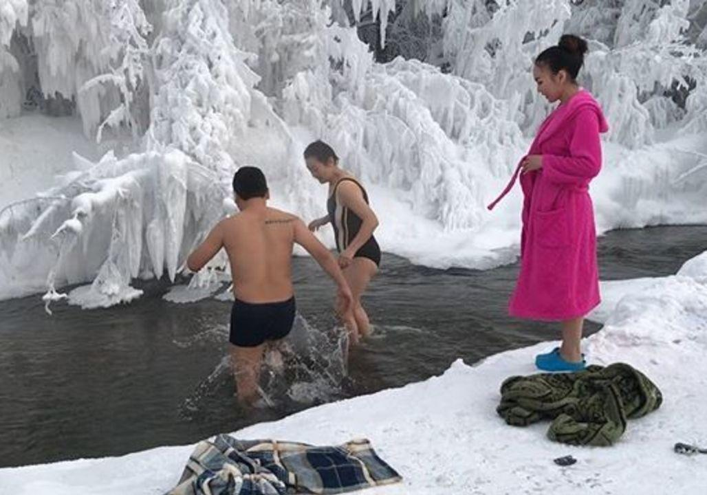 <p>Brave tourists took a plunge into a river in the world's coldest village, Oymyakon, while on a January tour of the glacial region in eastern Russia.</p><p>The uploader said temperatures fluctuated between minus 44 and minus 50 degrees Celsius during their trip. Credit: Instagram/sakhamin via Storyful</p>
