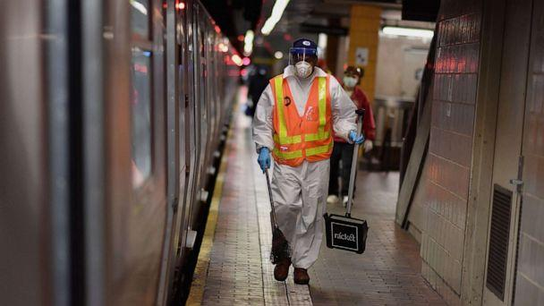 PHOTO: An MTA worker cleans subway trains at a station, May 7, 2020, in New York City. (Angela Weiss/AFP via Getty Images)