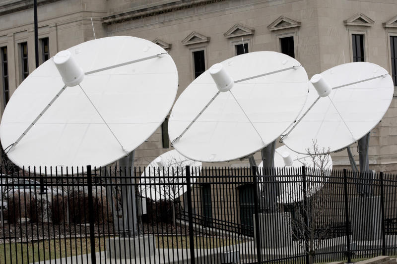 "In this Nov. 21, 2019 photo, satellite dishes are seen on the property of KETV, an ABC-affiliated television station in Omaha, Neb. An estimated 500,000 households nationwide don't have access to local broadcast channels because of a complicated federal law and a decades-long dispute between local broadcasters and satellite television providers. Households in the nation's ""neglected markets"" _ rural areas that can't get local broadcast signals, are forced to rely on satellite service with news from other states. (AP Photo/Nati Harnik)"