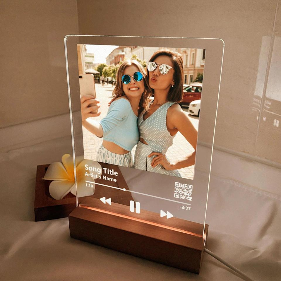 <p>If you and your bestie have a song that signifies your vibe, the <span>Custom LED Music Plaque</span> ($20, originally $22) is such a cute find. They can display this on their vanity or desk. You can customize it with the song that embodies your friendship along with a cute picture of you two!</p>