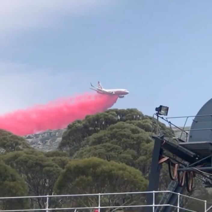 A plane releases fire retardant on an area in Perisher Valley, New South Wales, Australia, in this January 10, 2020 still frame obtained from social media video.