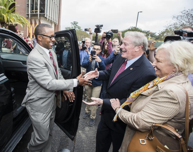 Willie Taggart (L) is greeted by Florida State University president John Thrasher and his wife, Jean, as he arrives to be introduced as the school's new football head coach. (AP Photo/Mark Wallheiser)