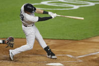 New York Yankees' Luke Voit hits a three-run home run during the first inning of a baseball game against the Toronto Blue Jays on Tuesday, Sept. 15, 2020, in New York. (AP Photo/Adam Hunger)