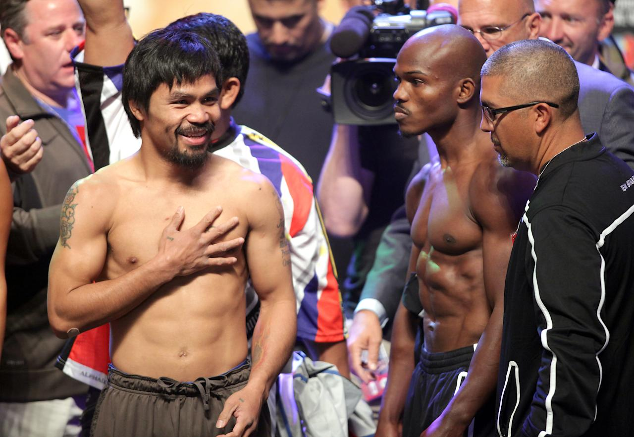 Boxers Manny Pacquiao (L) and Timothy Bradley during the weigh-in on June 8, 2012, for their bout at the MGM Grand Hotel/Casino in Las Vegas, Nevada.  Pacquiao weigh-in at 147 lbs. Bradley weigh-in at 146 lbs. Pacquiao will defend his WBO welterweight title against Bradley when the two meet in the ring on June 9 at the MGM Grand Garden Arena in Las Vegas.       AFP PHOTO / John GURZINSKIJOHN GURZINSKI/AFP/GettyImages
