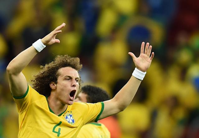 Brazil defender David Luiz celebrates after forward Fred (not pictured) scored during a World Cup Group A match against Cameroon at the Mane Garrincha National Stadium in Brasilia on June 23, 2014 (AFP Photo/Pedro Ugarte)