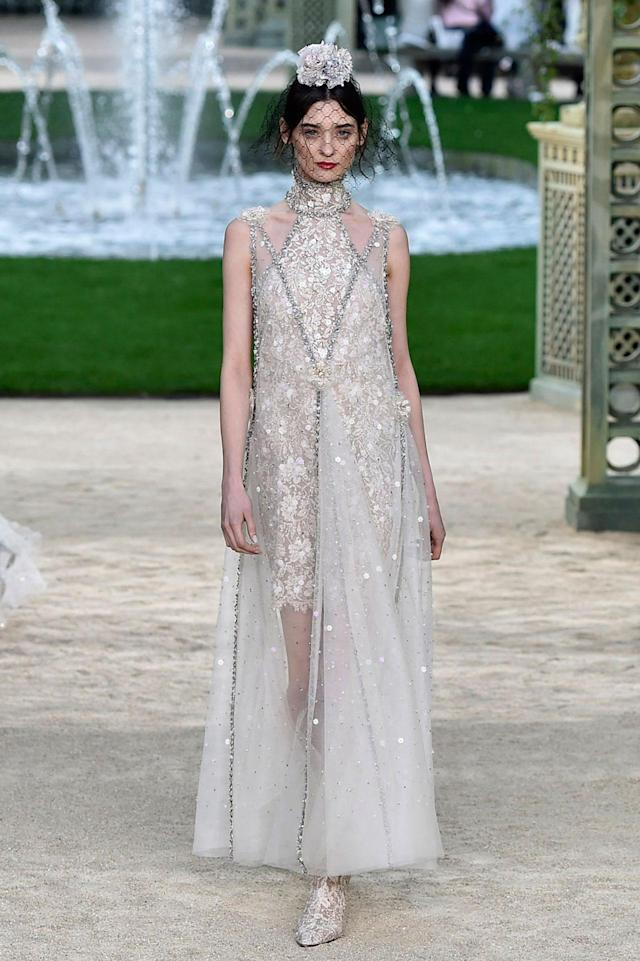 "<p>Model wears a couture version of the ""choker dress,"" decorated with floral appliqués and beads from the Chanel SS18 Haute Couture show.(Photo: Getty Images) </p>"