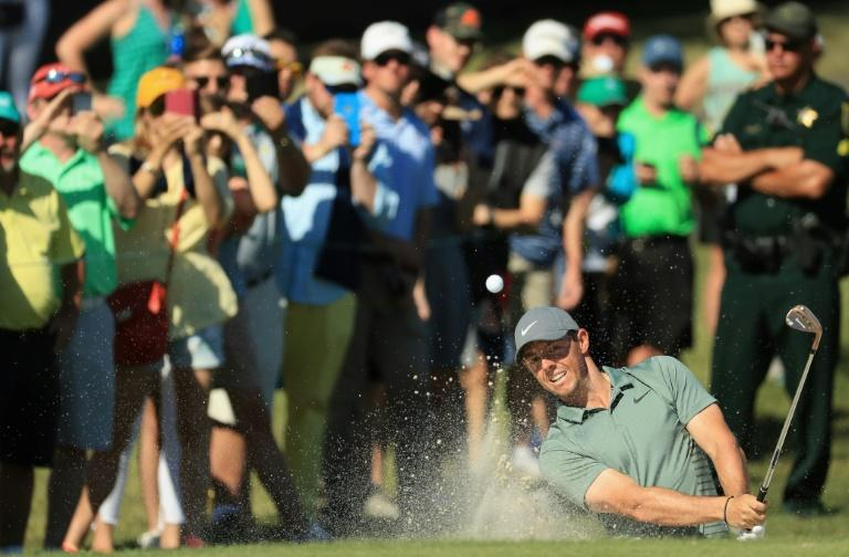 Rory McIlroy blasted out of a bunker to two feet to birdie the par-5 fourth and sank a 12-foot birdie putt at nine to surge into the title hunt at the Arnold Palmer Invitational