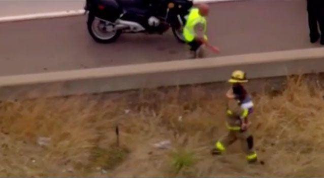 Footage shows Mr Lopez holding the little girl and walking away from the crash. Photo: NBC