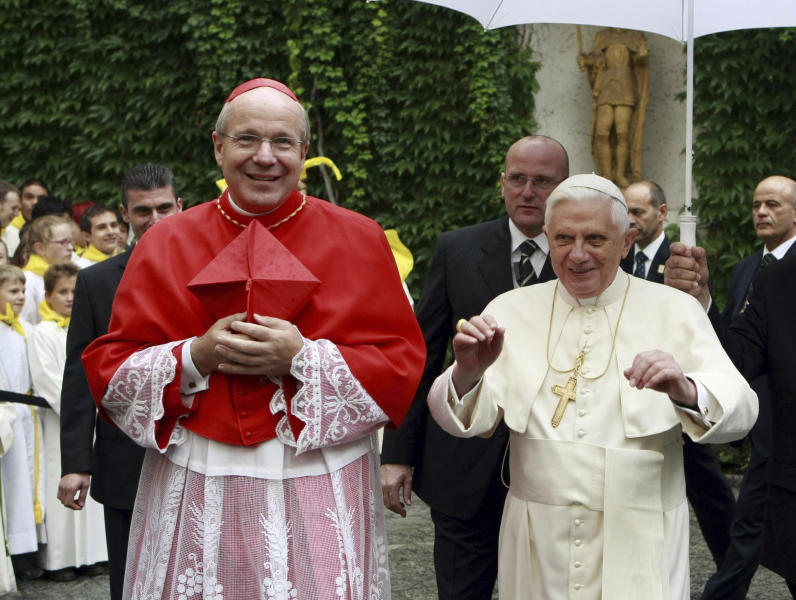 """FILE - In this Sept. 9, 2007 file photo Pope Benedict XVI, right, and Austrian Cardinal Christoph Schoenborn arrive at the archbishop's palace in downtown Vienna, Austria. Multilingual and respected by Jews, Muslims and Orthodox Christian, Benedict XVI's friend and former pupil was one of the cardinal electors in the 2005 papal conclave that chose the German as head of the Catholic church. A scholar who is at home in the pulpit, Schoenborn also is well connected in the Vatican _ and appears willing to make it his home, if reluctantly. Asked if he would like to succeed Benedict on news of the pontiff's plan to step down, he said: """"my heart is in Vienna, my heart is in Austria _ but naturally with the whole Church as well."""" (AP Photo/Robert Jaeger, Pool, File)"""
