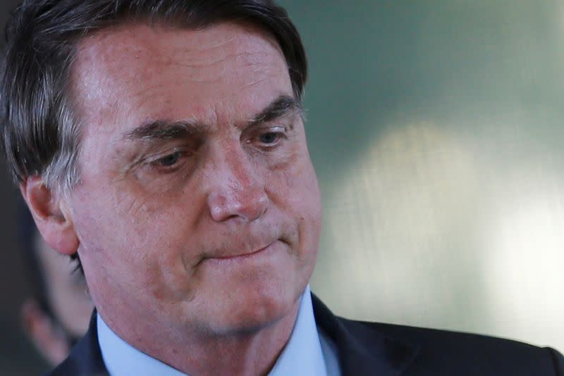 FILE PHOTO: Brazil's President Jair Bolsonaro looks on after a meeting at the Ministry of Defense headquarters, amid the coronavirus disease (COVID-19) outbreak, in Brasilia