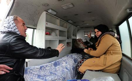Palestinians gesture as an ambulance transports the dead body of a person, at Rafah border crossing with Egypt, in the southern Gaza Strip January 8, 2019. REUTERS/Ibraheem Abu Mustafa