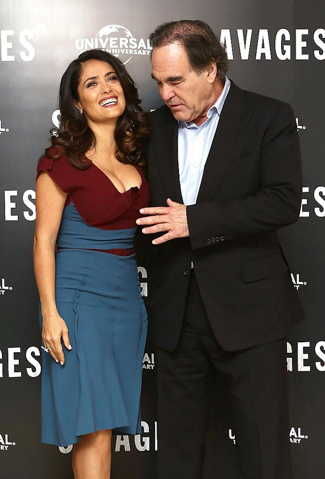 "Whoa! Director Oliver Stone was caught in a bit of a compromising position when he attended a London photocall for the film ""Savages"" with the voluptuous Salma Hayek on Wednesday. Despite the, er, uncomfortable scenario, Salma kept smiling like a pro! (9/19/2012)"