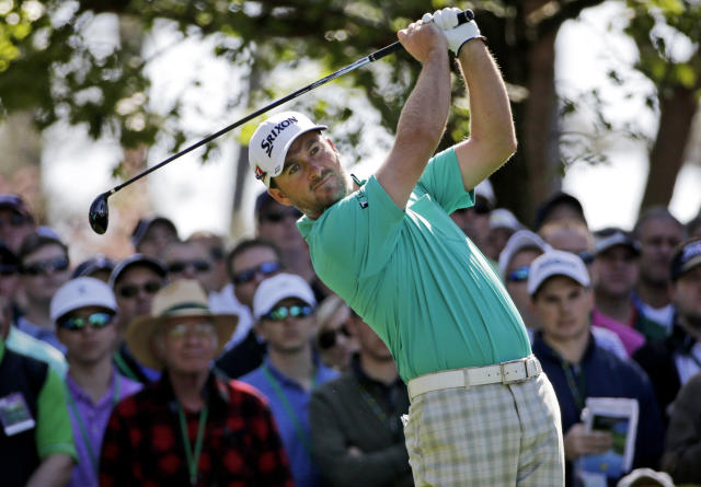 Graeme McDowell, of Northern Ireland, watches his tee shot on the fourth hole during the first round of the Masters golf tournament Thursday, April 10, 2014, in Augusta, Ga. (AP Photo/David J. Phillip)