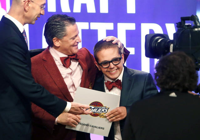 "FILE – In this May 21, 2013, file photo, <a class=""link rapid-noclick-resp"" href=""/nba/teams/cle/"" data-ylk=""slk:Cleveland Cavaliers"">Cleveland Cavaliers</a> owner Dan Gilbert congratulates his son, Nick Gilbert, after the team won the NBA basketball draft lottery in New York. Nick Gilbert underwent major brain surgery this week. A team spokesman said the 21-year-old will have the operation in Detroit. (AP Photo/Jason DeCrow, File)"